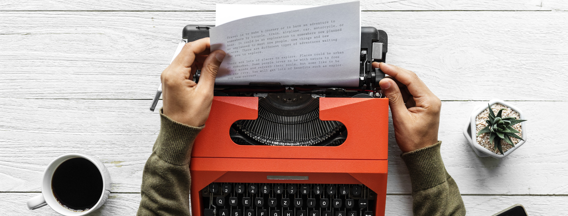 Aerial view of a man typing on a retro typewriter